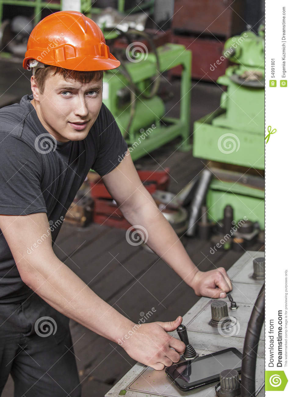 The young man working at the old factory on installation of equipment