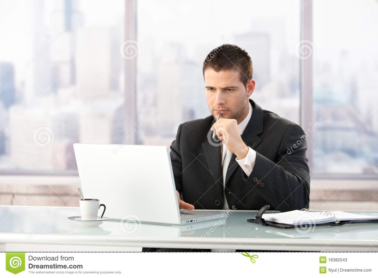 Young Manager Working On Laptop In Office Stock Photos ...