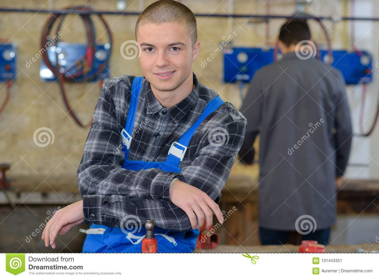 Young mechanic apprentices in workshop