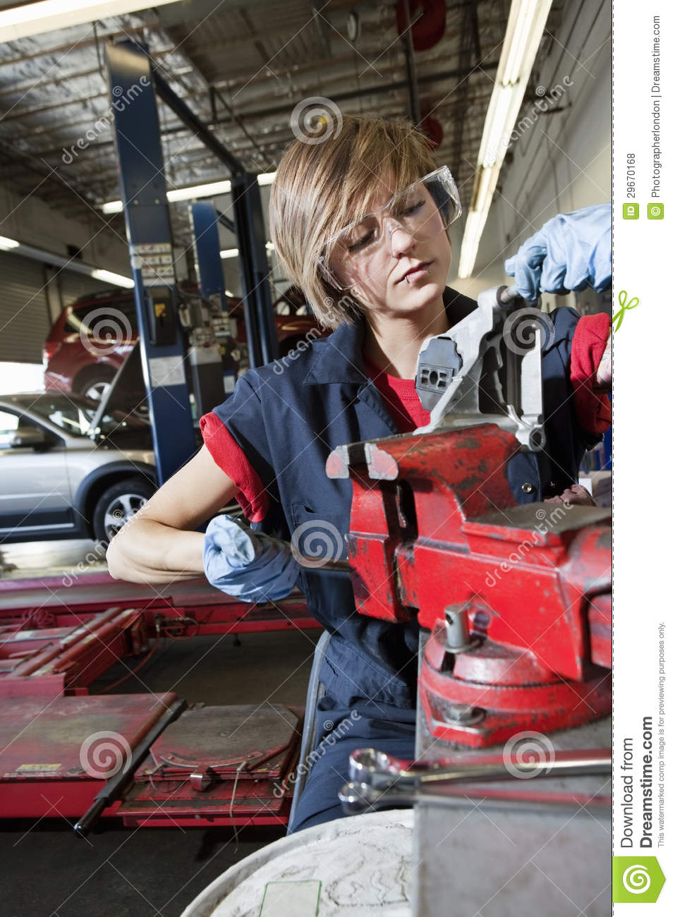 Young Mechanic In Protective Clothing Concentrating On Repairing – Machine Mechanic