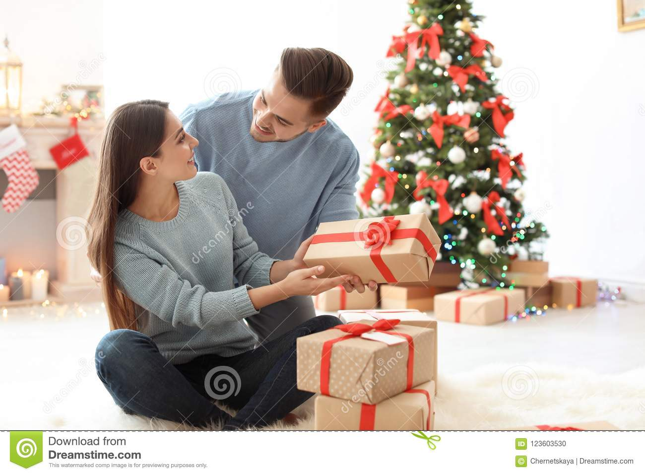 download young man giving christmas gift to his girlfriend stock photo image of girlfriend