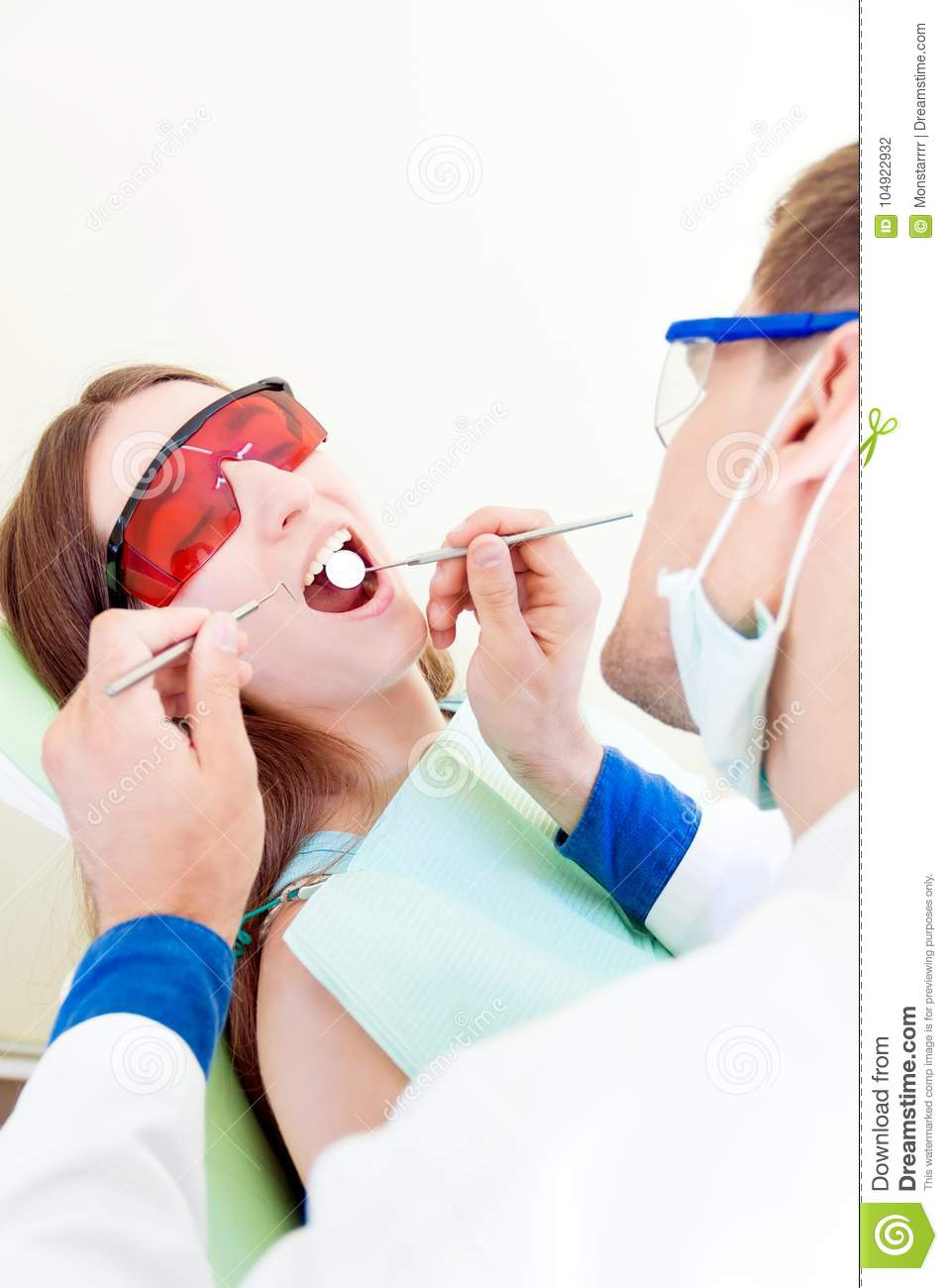Professional Dentist With Patient In Hospital Stock Photo