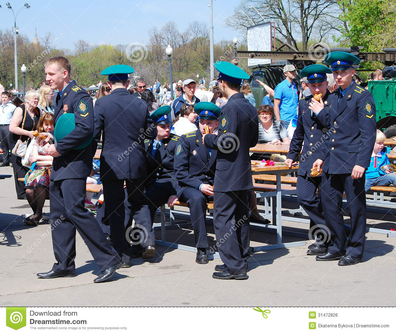 Young men in military uniform eat cakes. holiday decoration on the