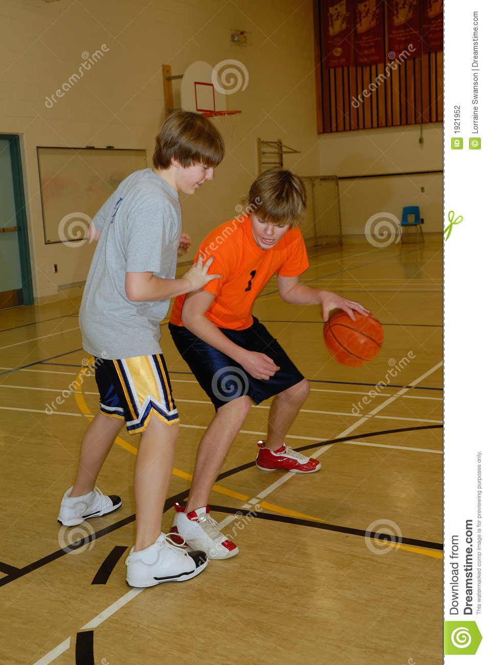 Young Men Playing Basketball