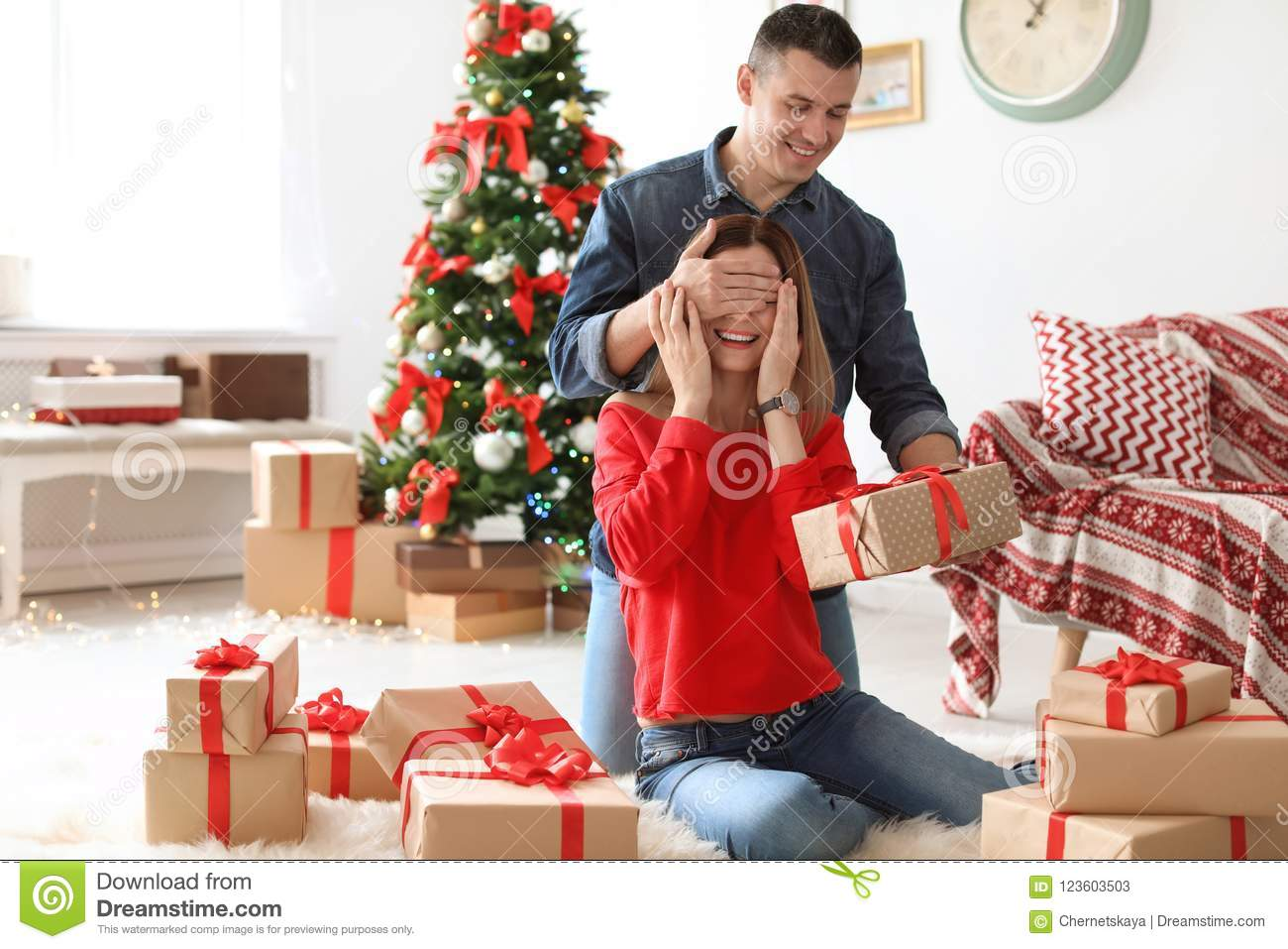 Young Man Surprising His Girlfriend With Christmas Gift Stock Image ...
