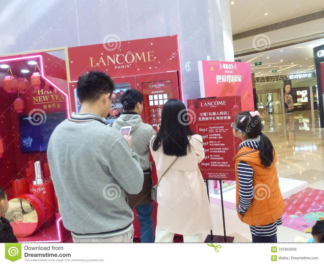 Shenzhen, China: Young Men And Women Are Getting Free Cosmetics