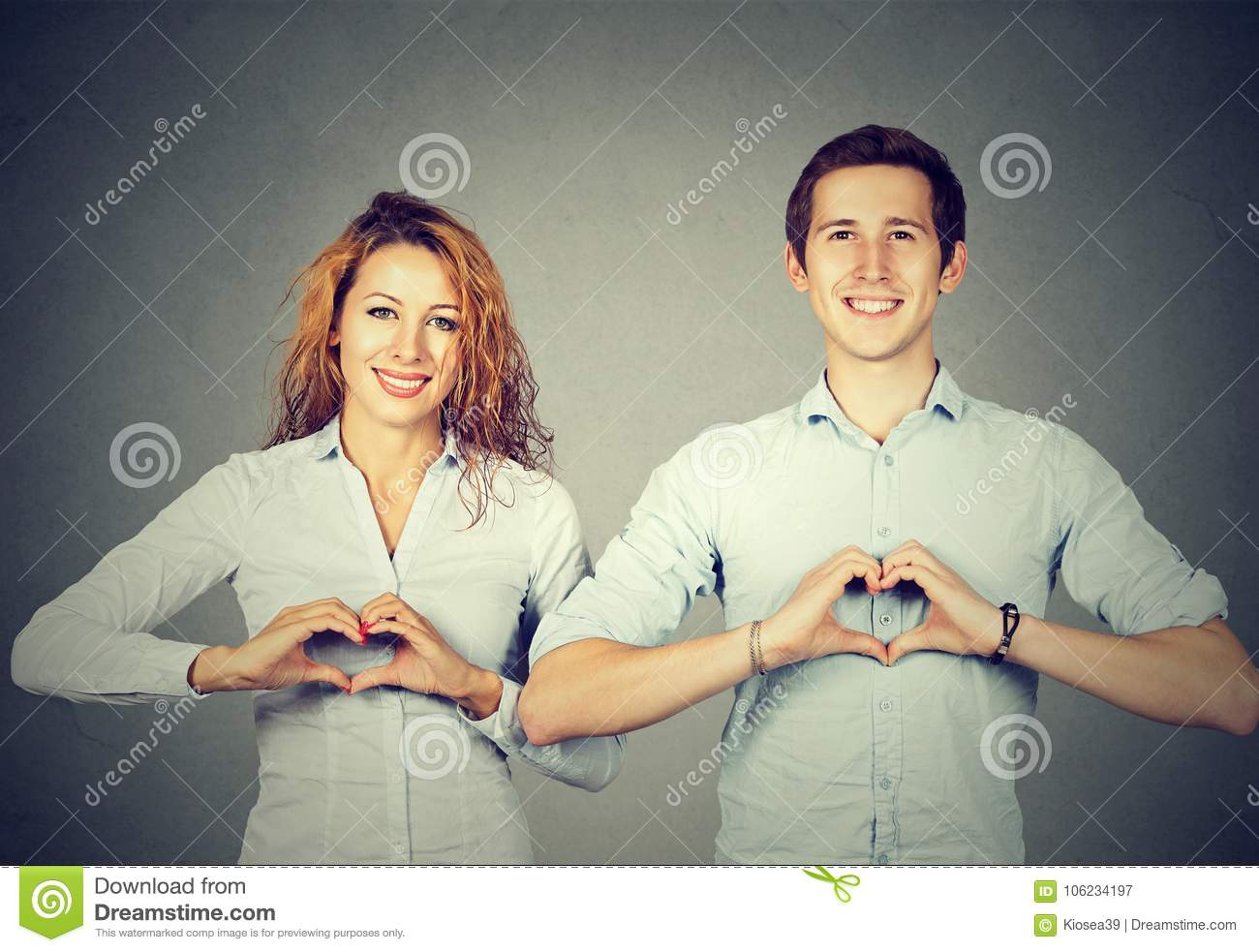 Cheerful people showing hearts with hands