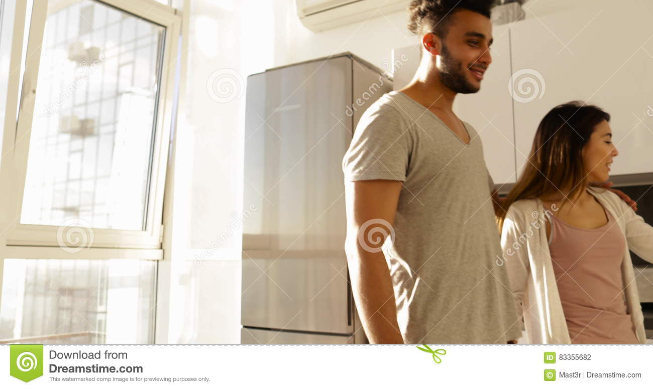 Young Mixed Race Couple In Kitchen Morning Sunlight, Cute Happy ...
