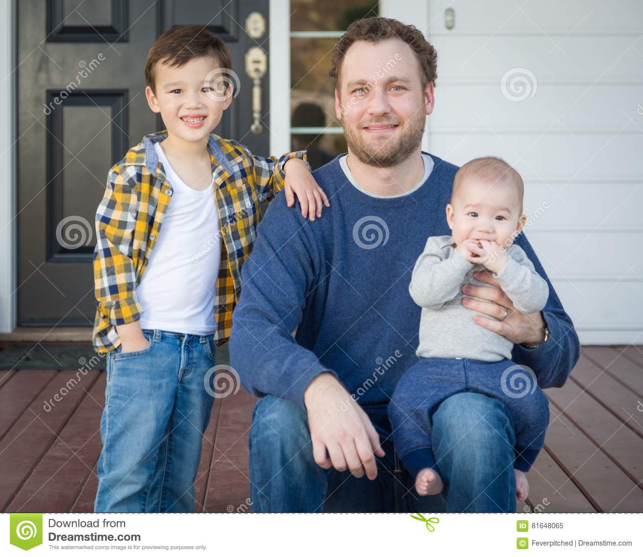 Mixed Race Father and His Two Sons on Front Porch