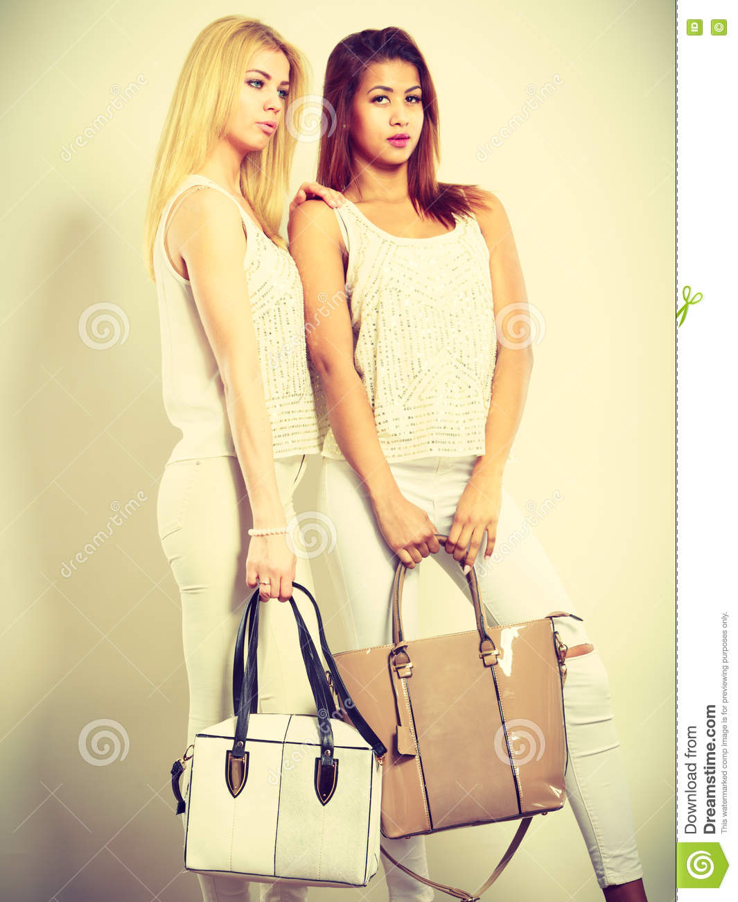 Young Models With Handbags. Stock Photo
