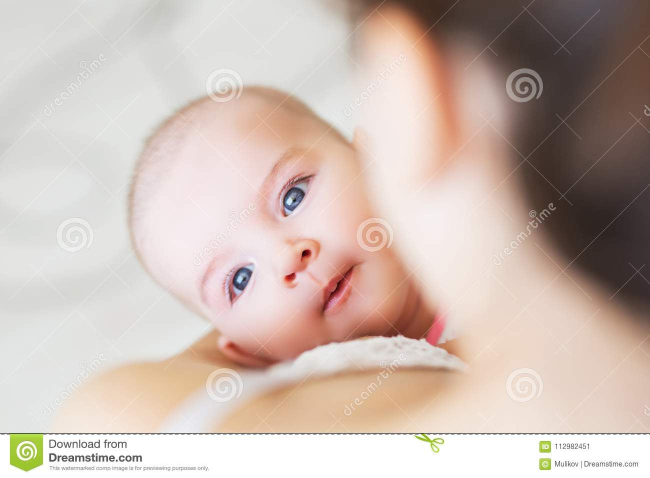 Young mom breast feeding her newborn child. Lactation infant concept. Mother feed her baby son or daughter with breast milk
