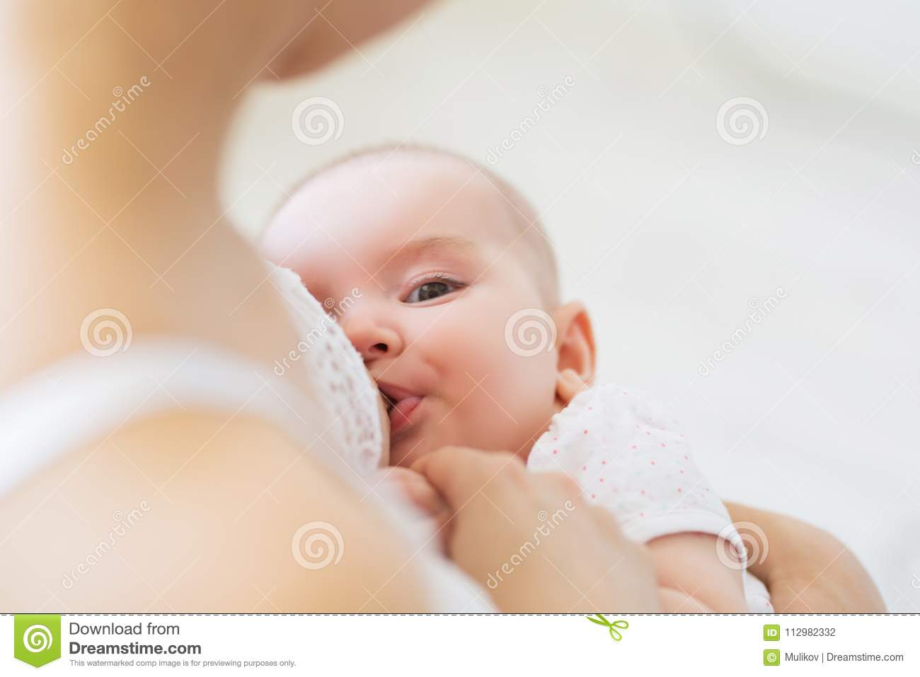 Young Mom Breast Feeding Her Newborn Child. Lactation Infant Concept ...