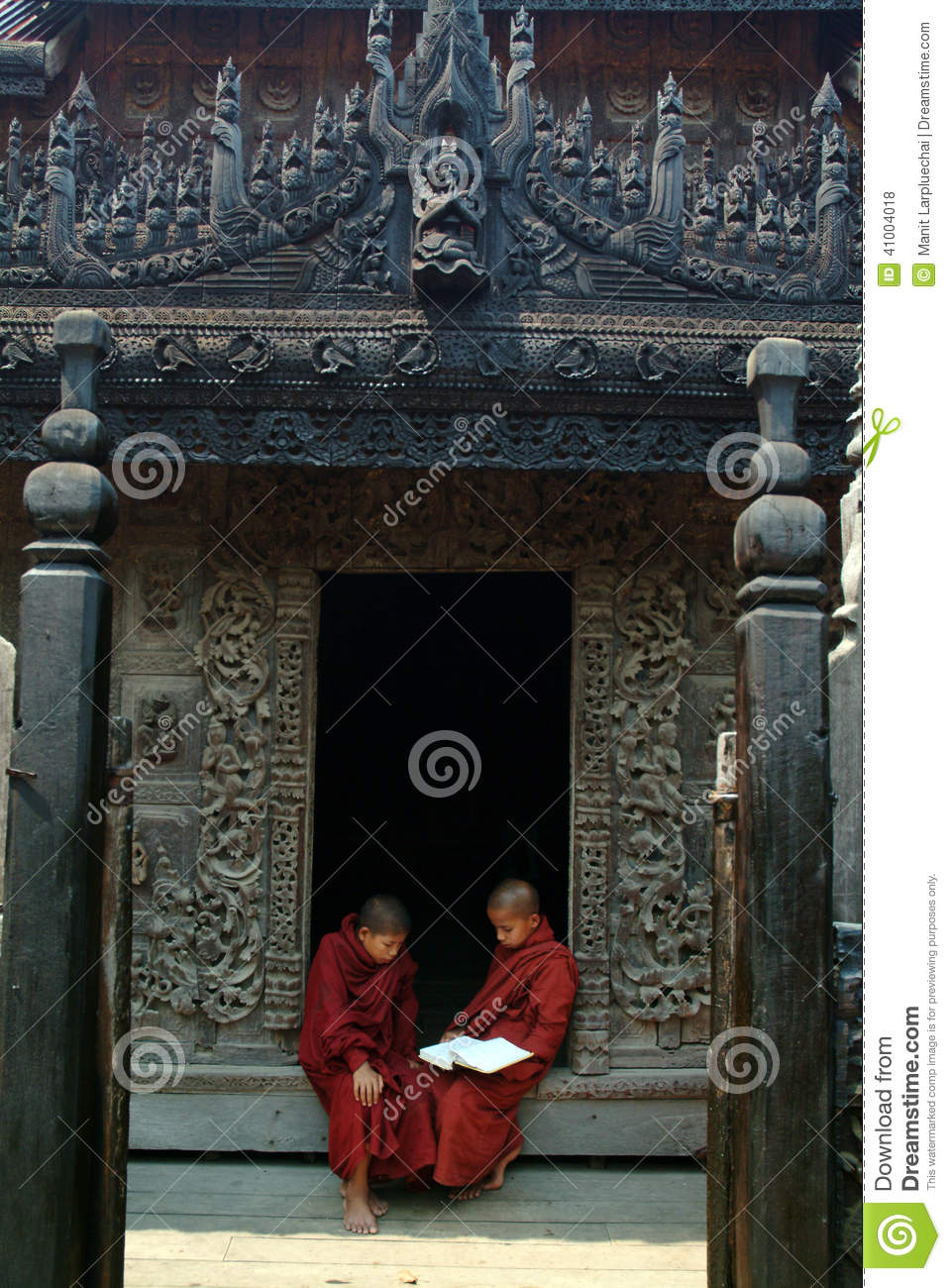 Young Monks Reading A Book At Shwenandaw Monastery