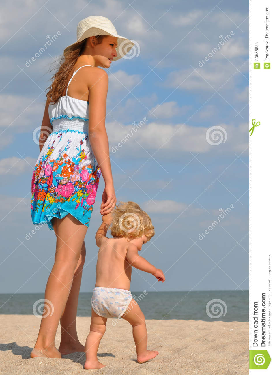 Young Mother With Baby On The Beach Stock Photo