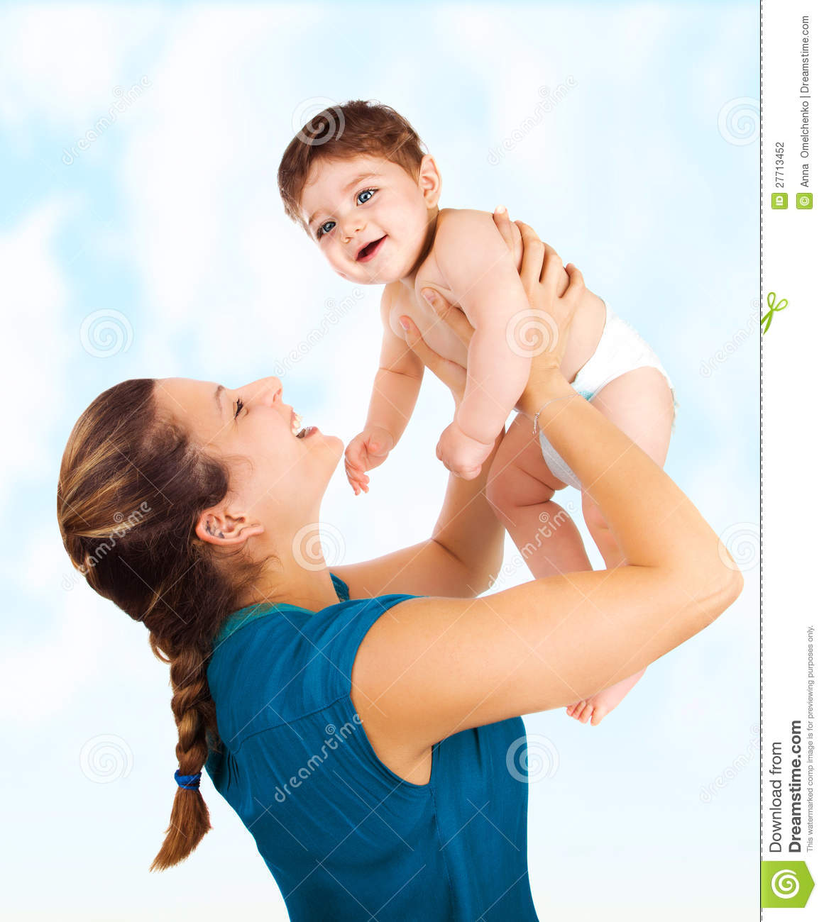 Photo of young beautiful mother with cute baby boy, smiling mommy lift ...
