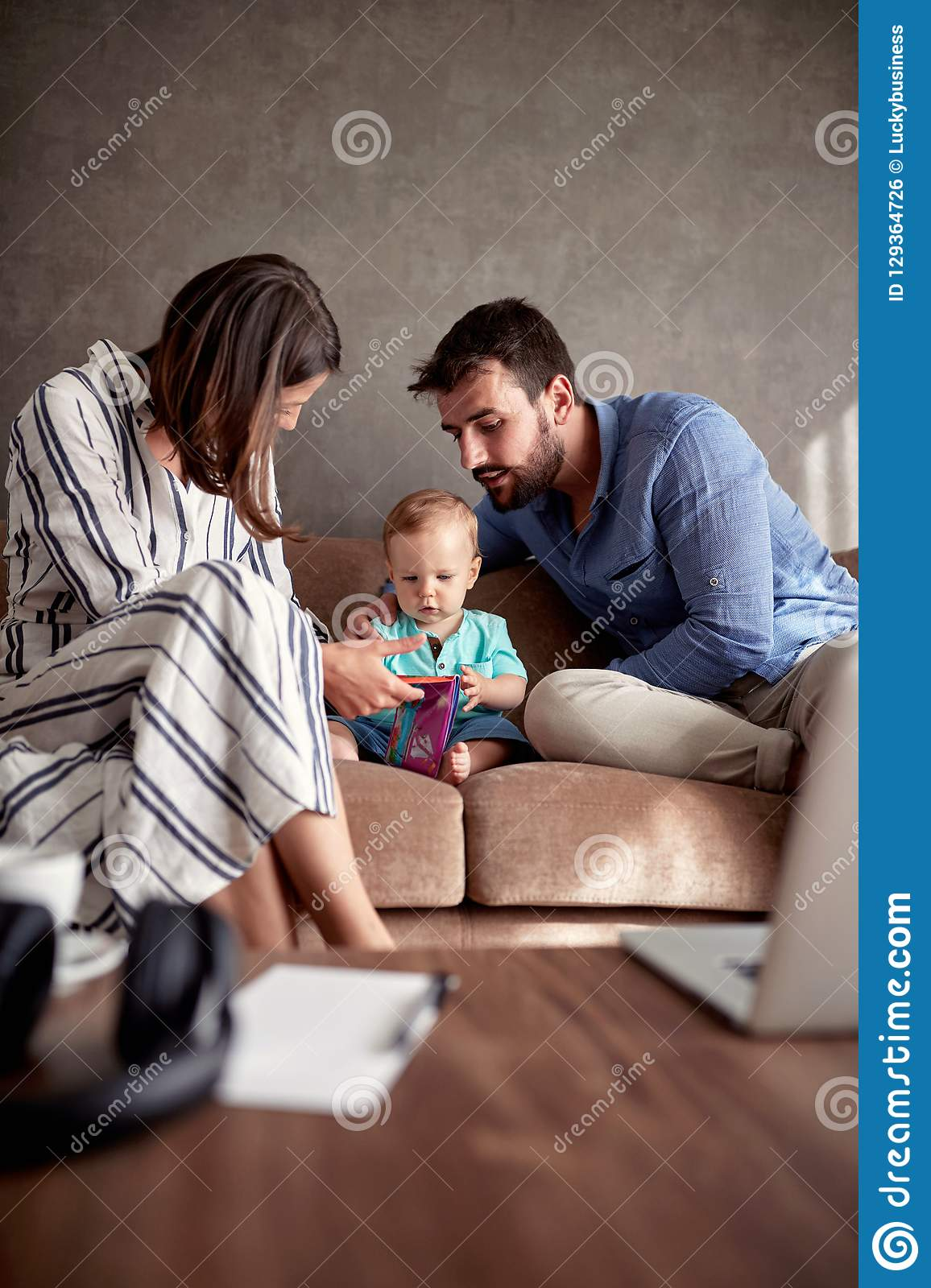 Mother, father and son, cute boy reading book, happy family life