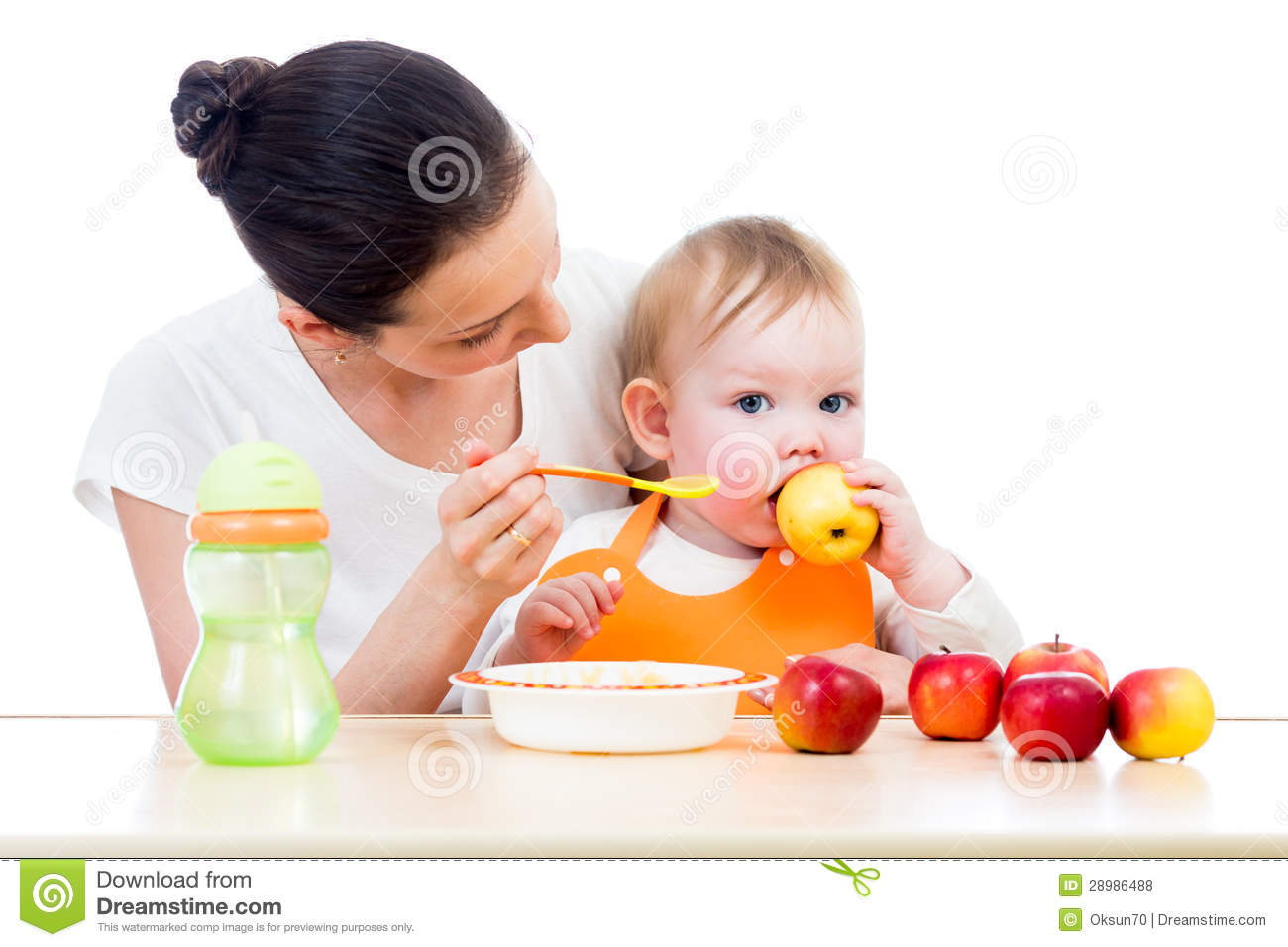 Young Mother Feeding Her Baby Conception Of Healthy