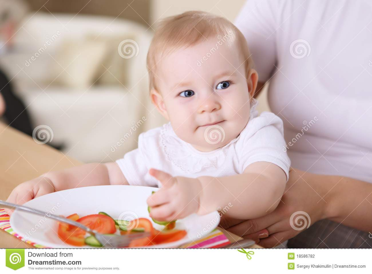 Mother Feeding Baby Boy At Home Kitchen Stock Image ...