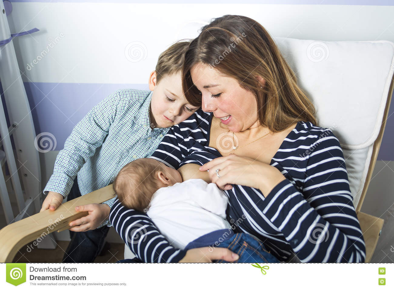 Download Young Mother Feeding Her Newborn Child. Stock Photo - Image of daughter, mother: 74575344