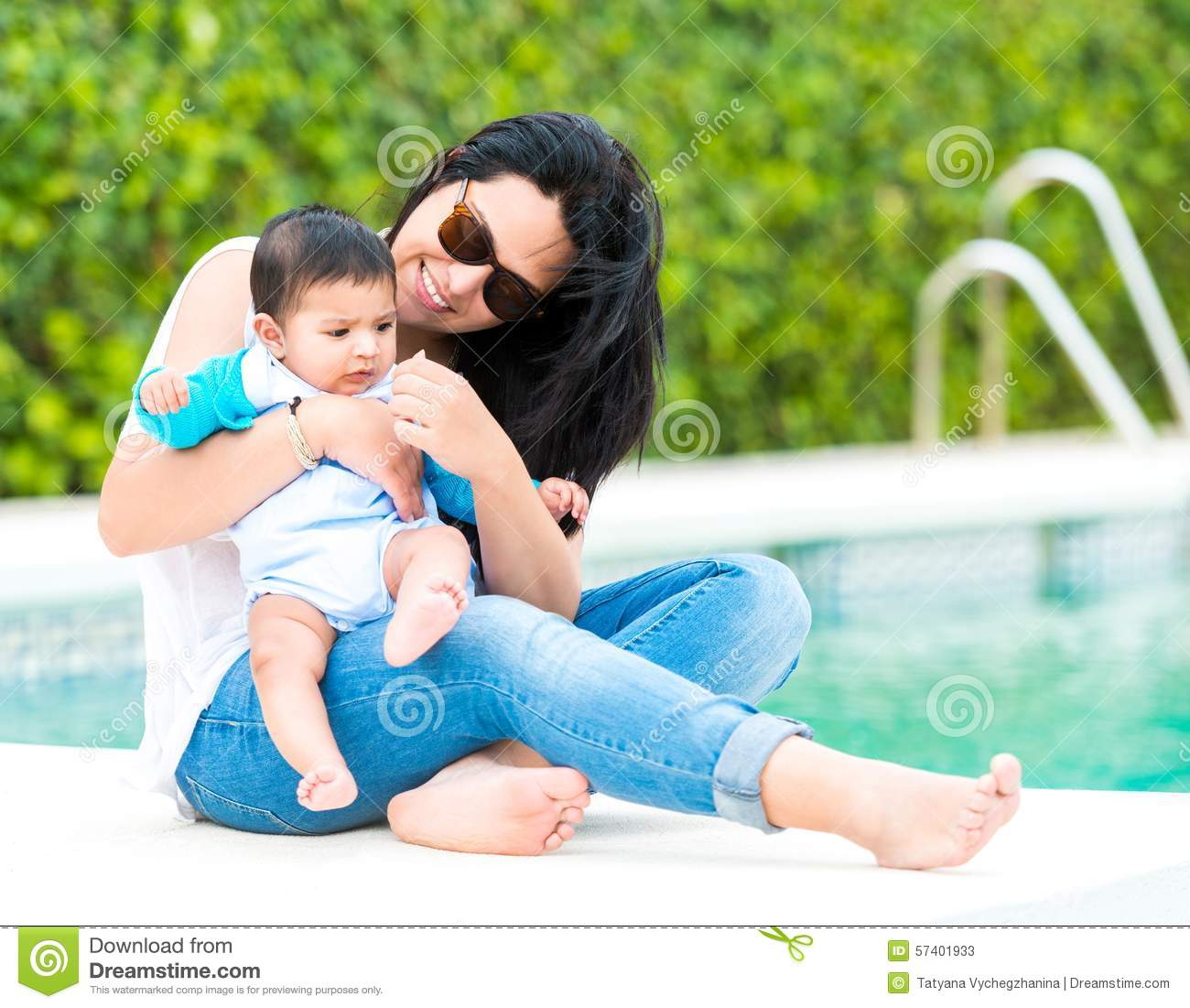 Young Mother With Her Baby Near The Swimming Pool Stock Photo Image 57401933