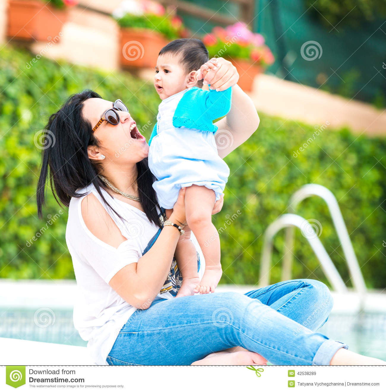 Young Mother With Her Baby Near The Swimming Pool Stock Photo Image 42538289