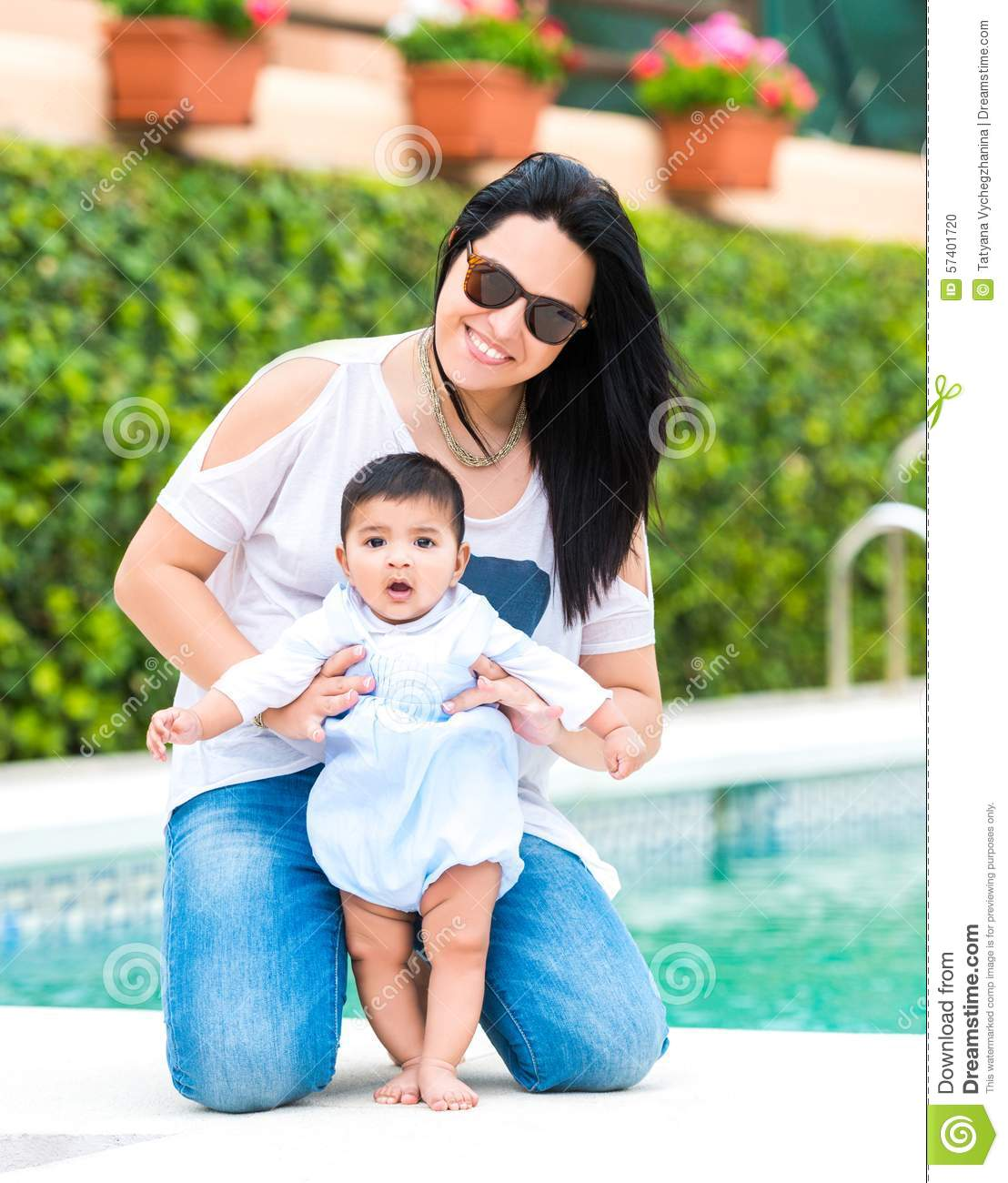 Young Mother With Her Baby Near The Swimming Pool Stock Photo Image 57401720