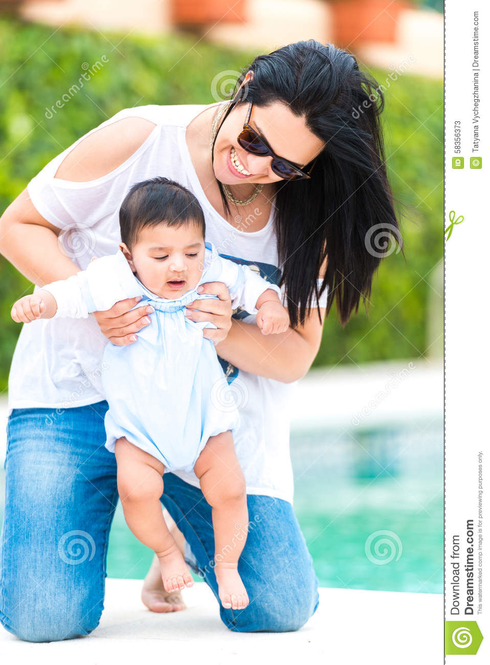 Young Mother With Her Baby Near The Swimming Pool Stock Photo Image 58356373