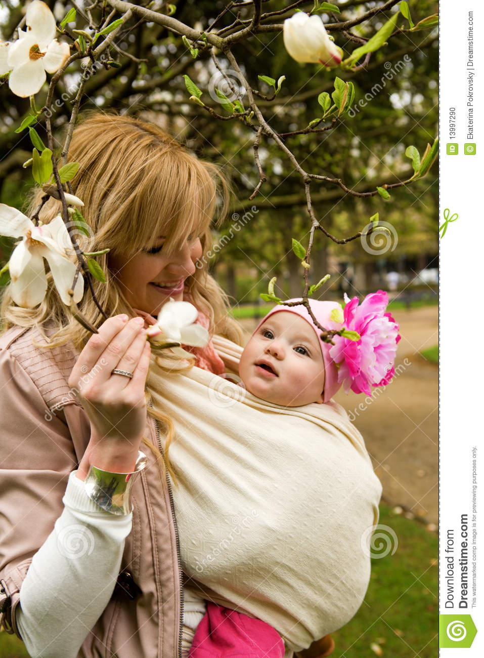 Young mother with her daughter in a garden
