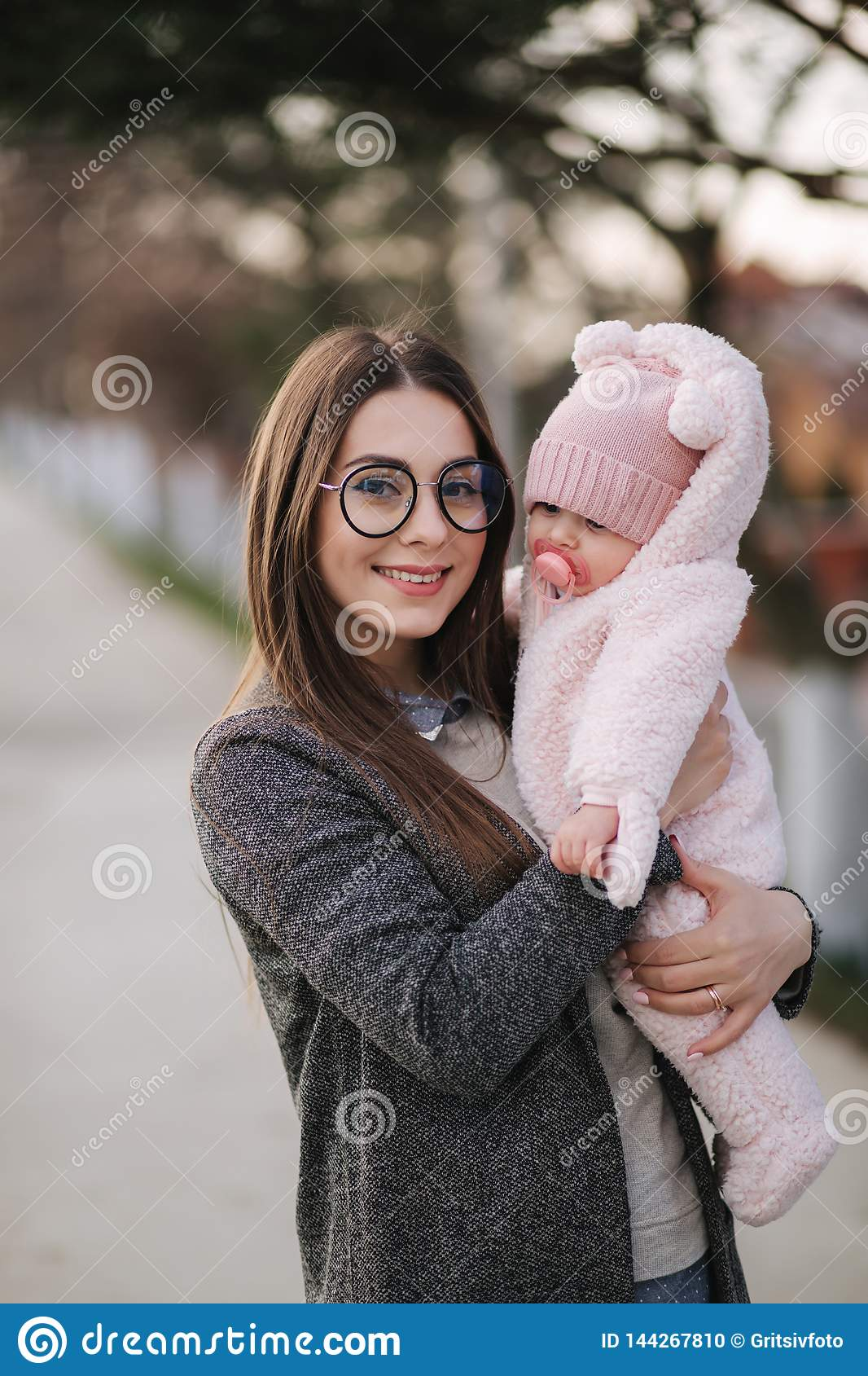 Young mother with her little baby. Mom hold baby on hands. Happy family