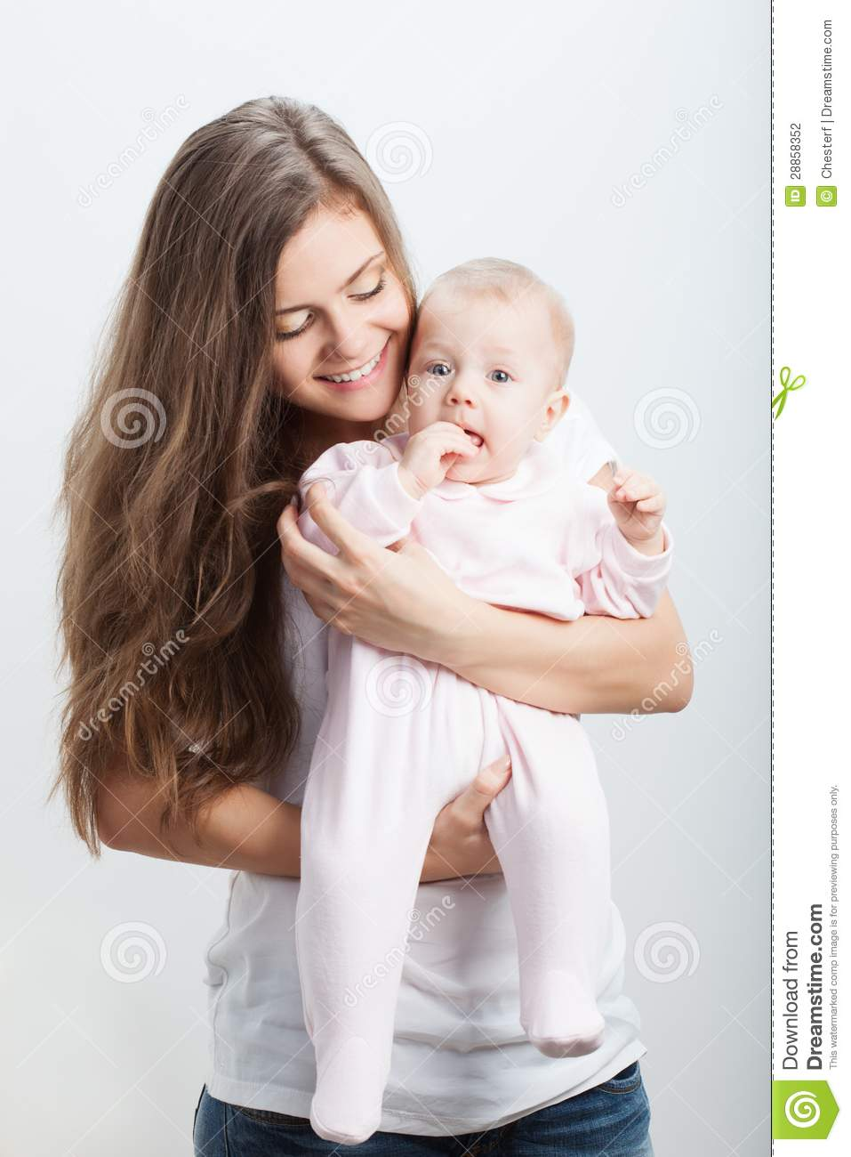 Young Mother Holding Her Baby Girl On Hands Stock Photo