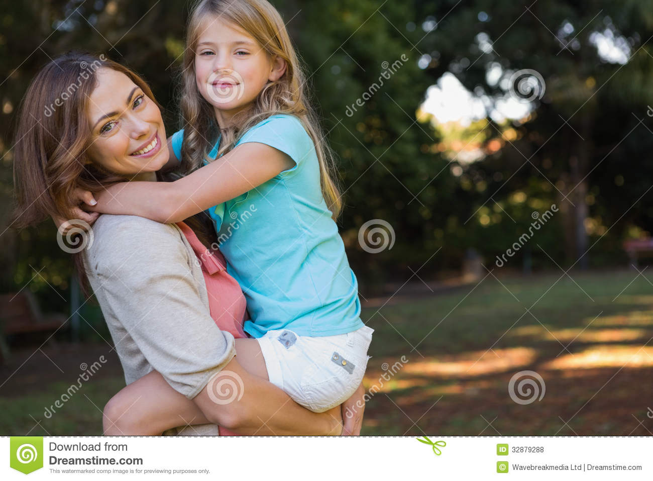 Young Mother Holding Her Daughter Royalty Free Stock