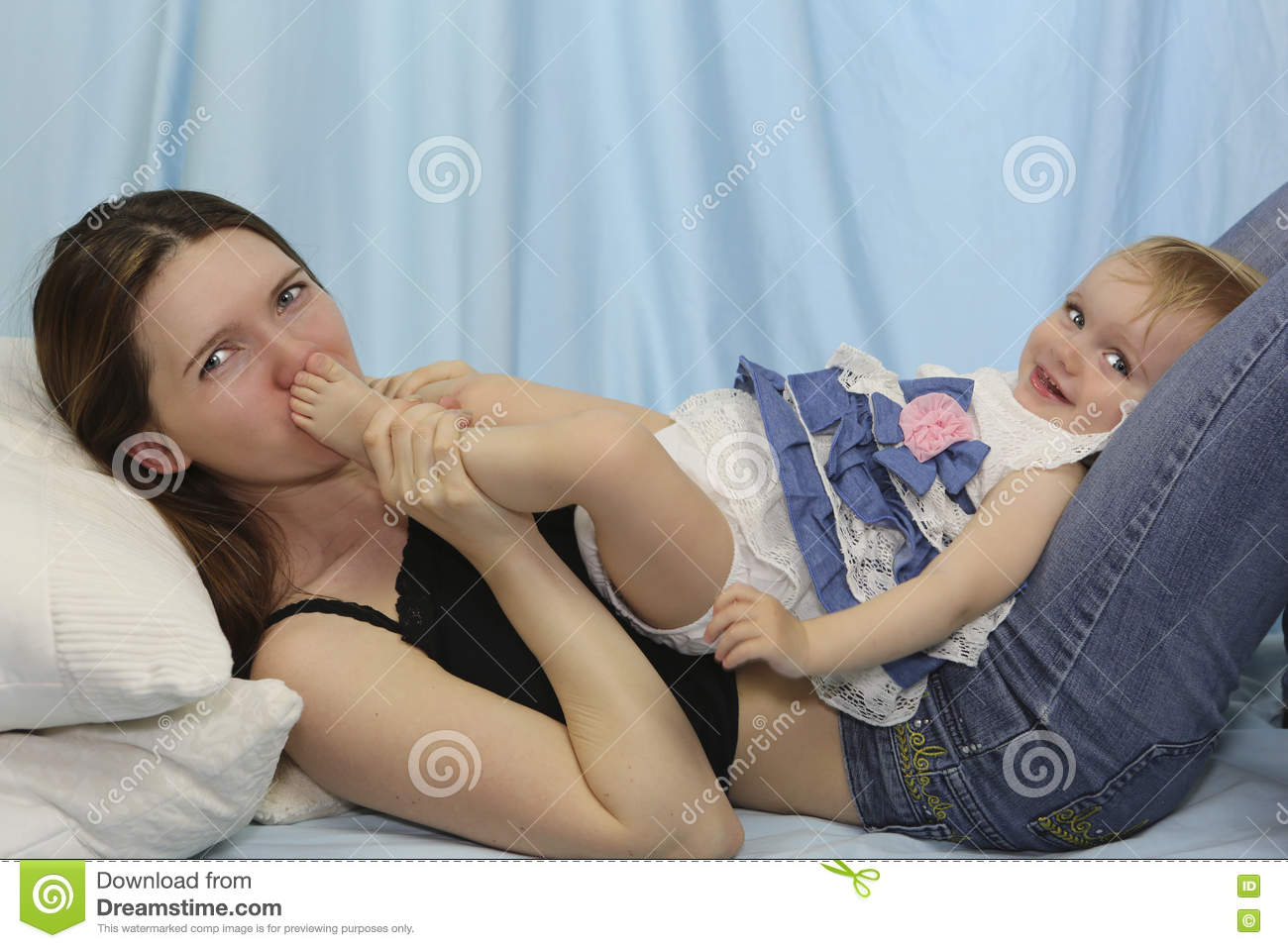 Young Mother Kissing Baby Feet. Happy Childhood Stock Image - Image ...