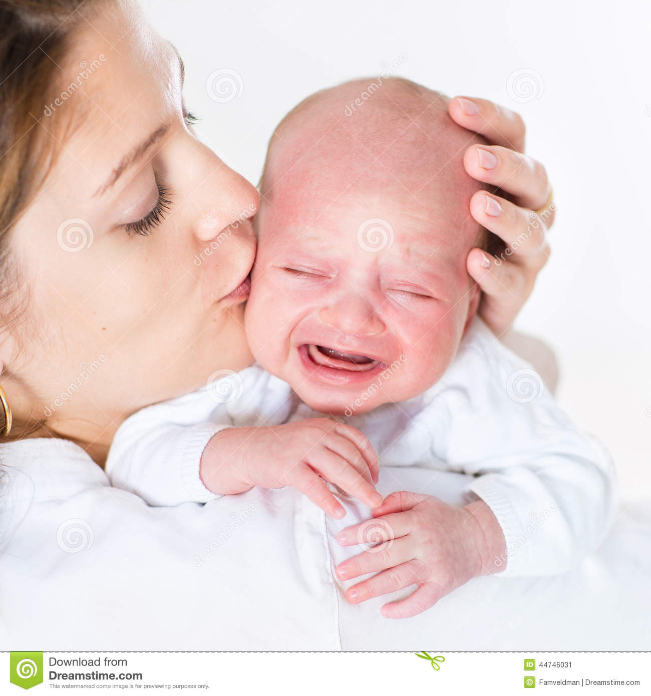 Young Mother Kissing Her Crying Newborn Baby Stock Photo ...