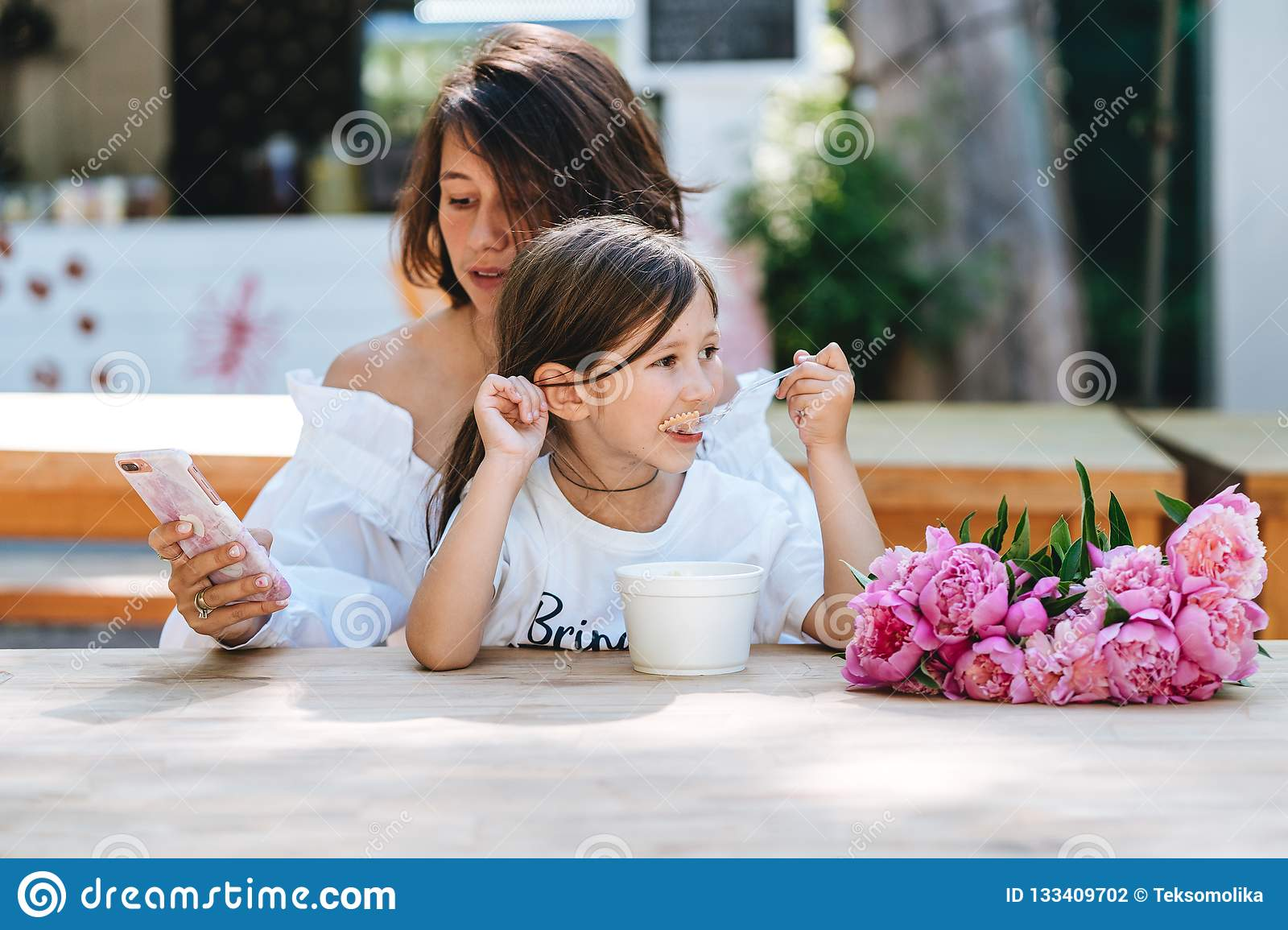 Remarkable, this young little girl mother daughter caption how paraphrase?