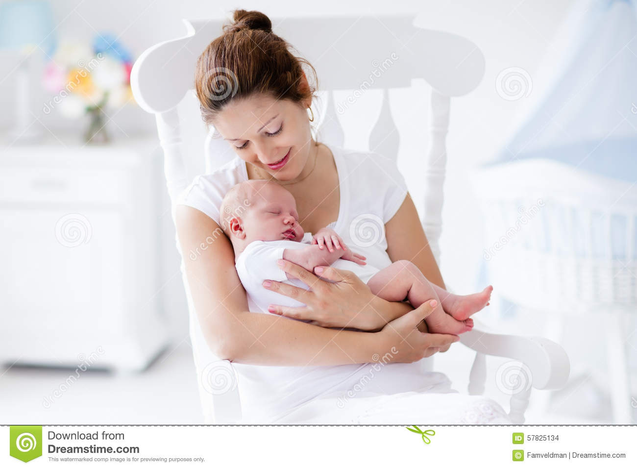 Young Mother And Newborn Baby In White Bedroom Stock Photo ...