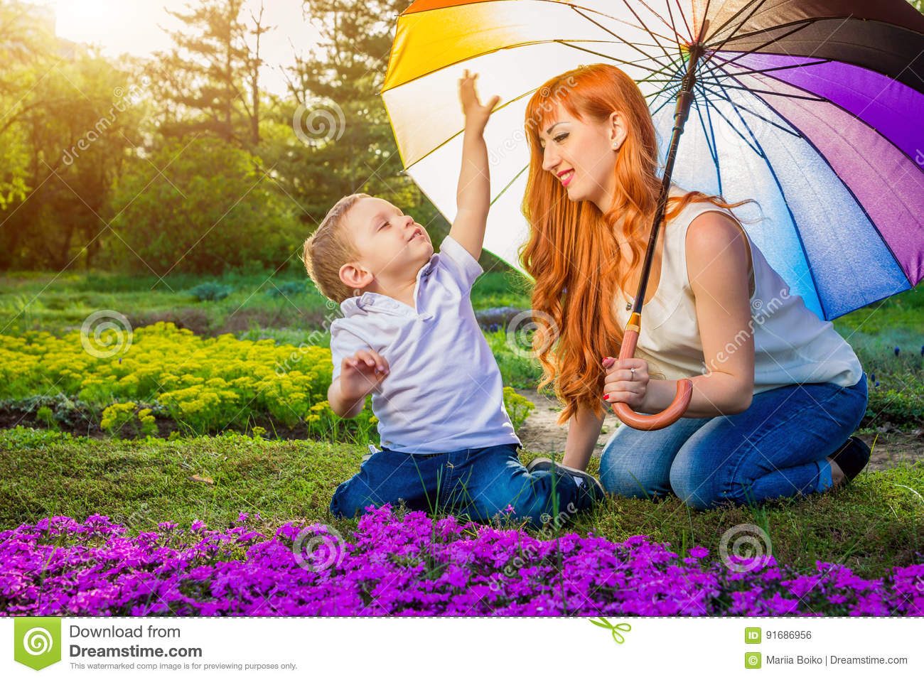Mother Playing With Kid In Garden In Village Stock Photo