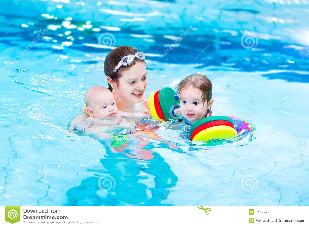 Young Mother Playing With Kids In Swimming Pool Stock ...