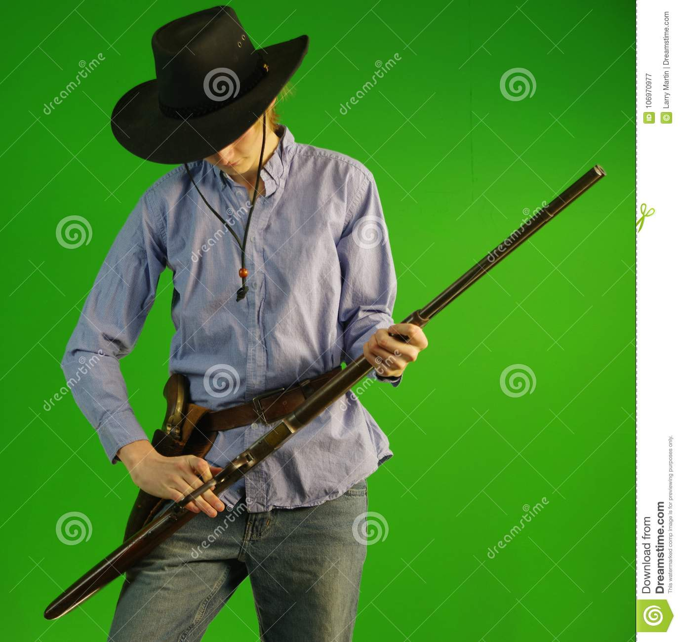 Young Cowboy With 1866 Winchester Rifle And Colt Revolver