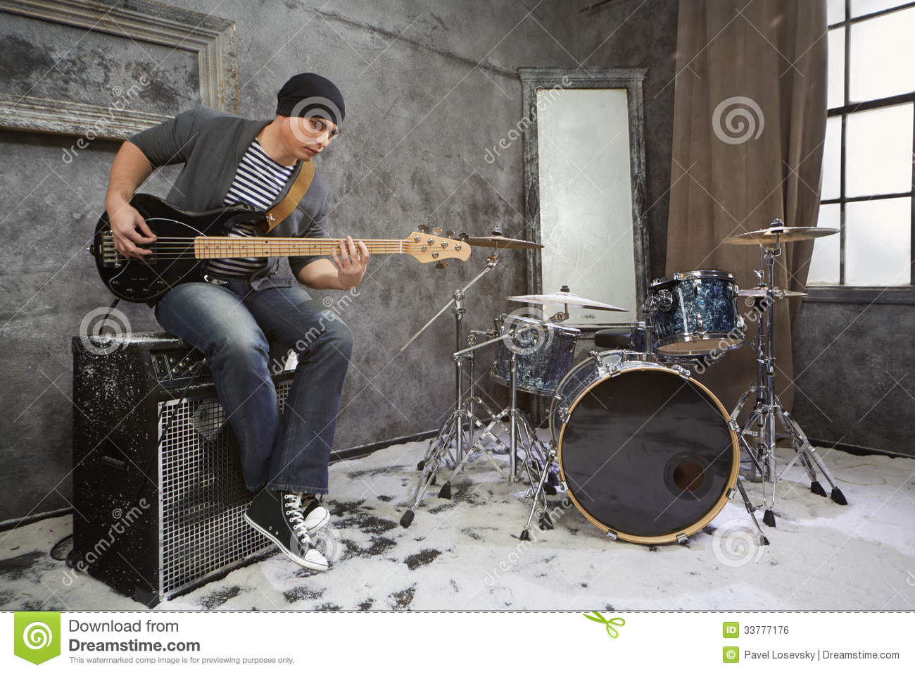 young musician plays bass electric guitar sitting on amplifier stock photo image 33777176. Black Bedroom Furniture Sets. Home Design Ideas