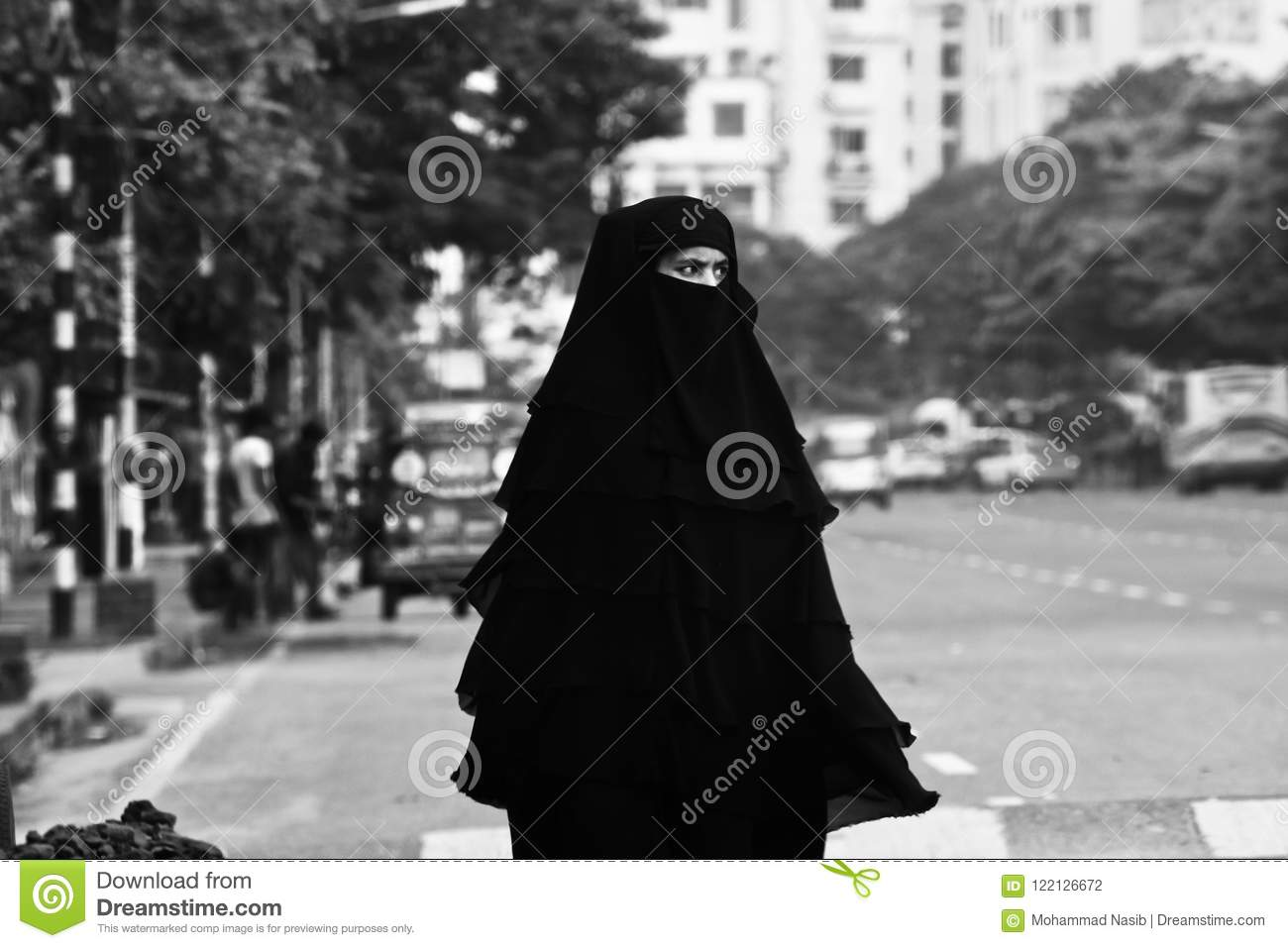 Download Young Muslim Lady Walking In The City Streets Unique Photo Editorial Photography - Image of photo, alone: 122126672