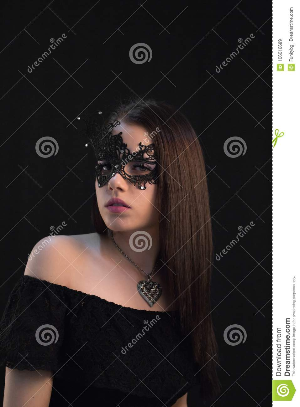 Young Mystic woman posing in mask