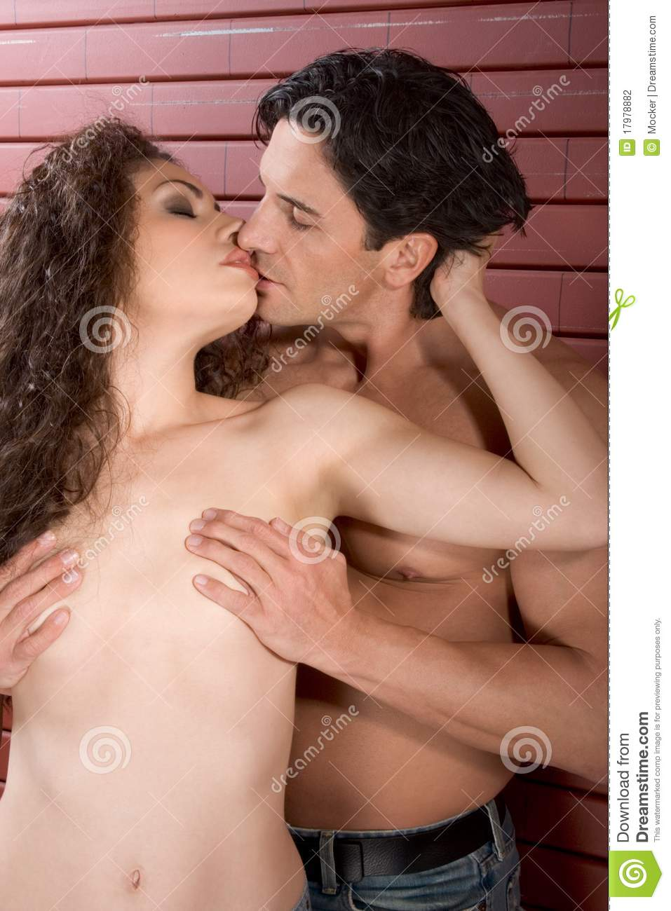 naked sexy man and sexy woman kissing