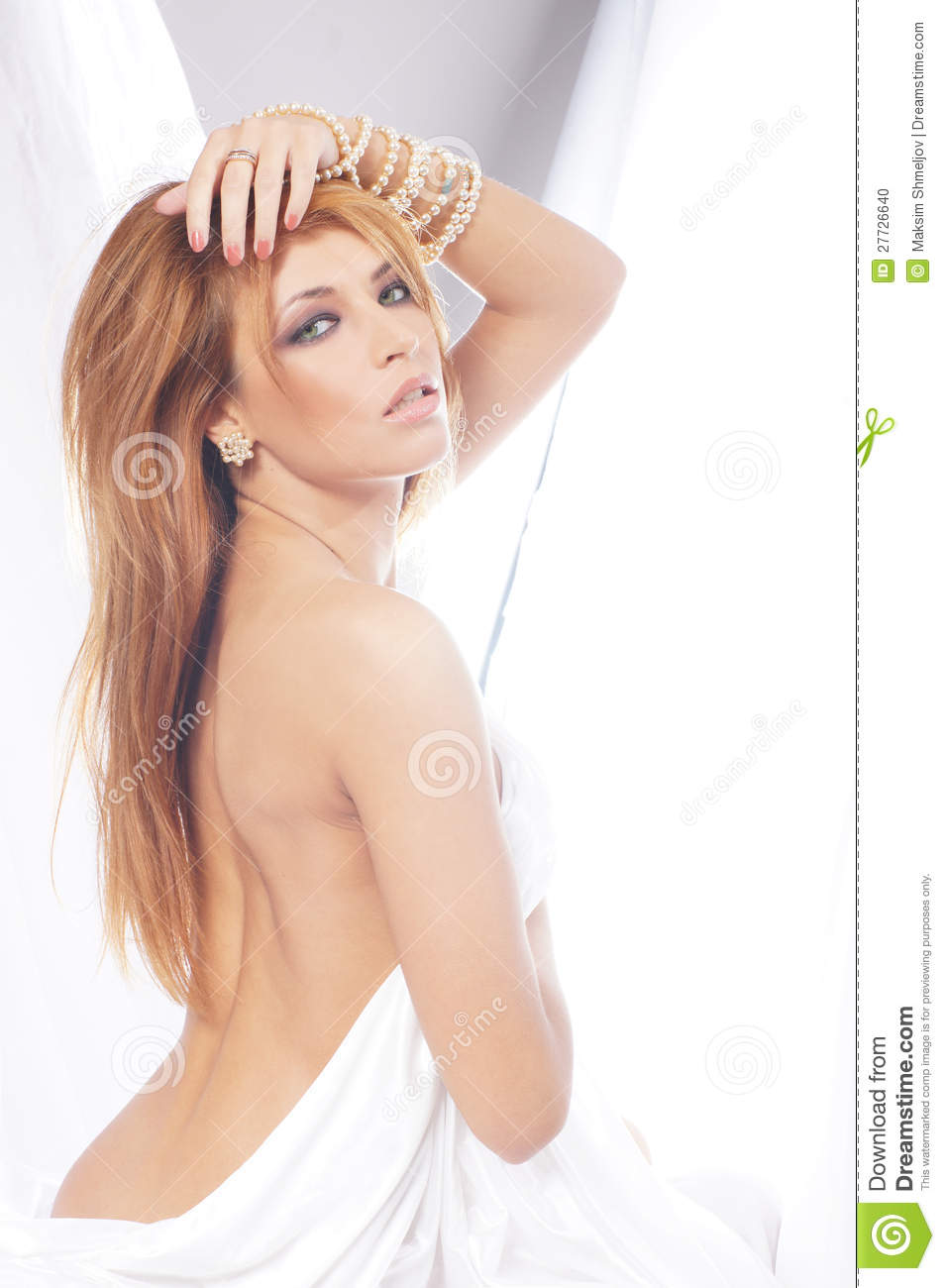 That redhead woman posing