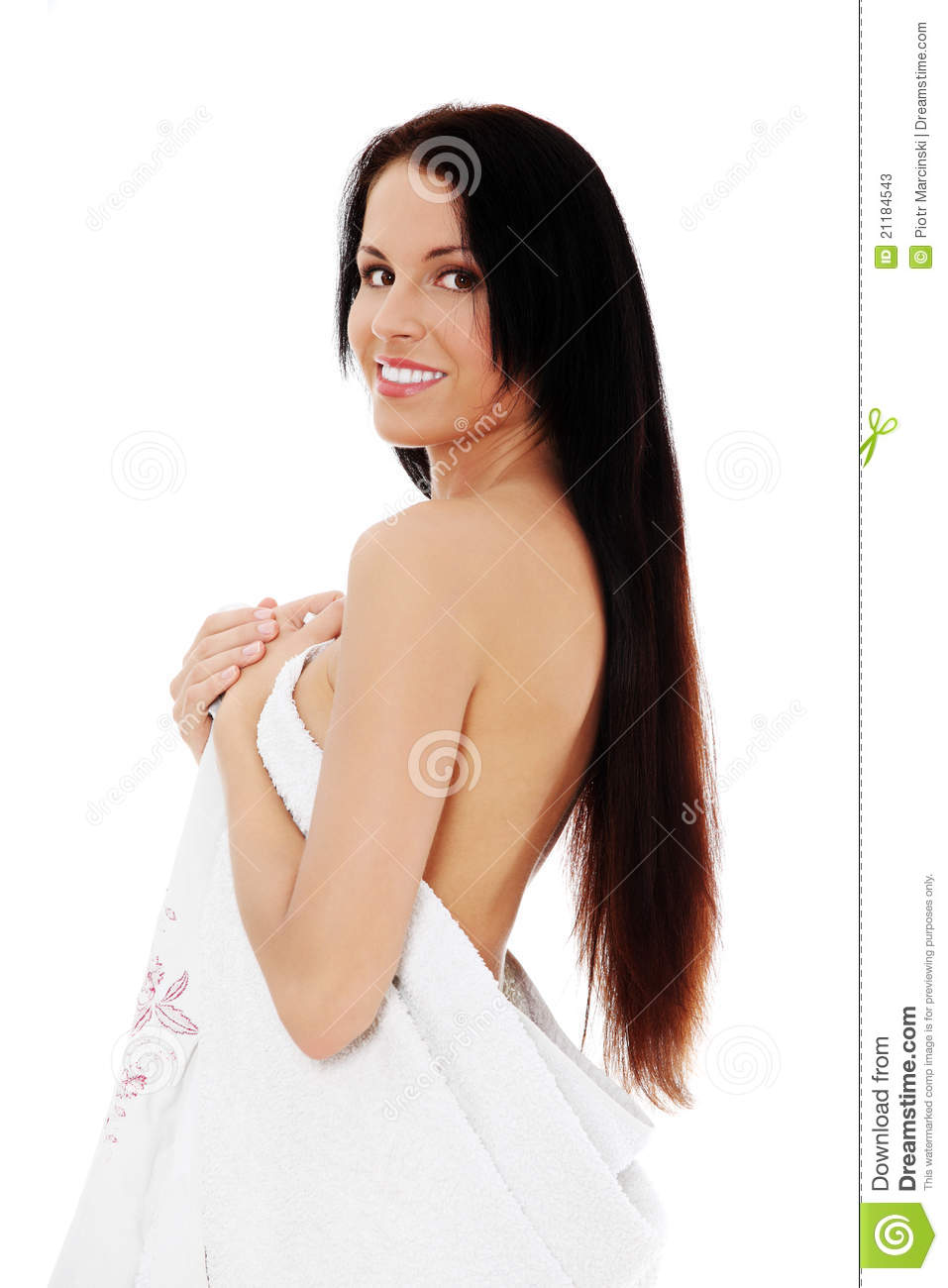 Young naked woman covering her self with towel