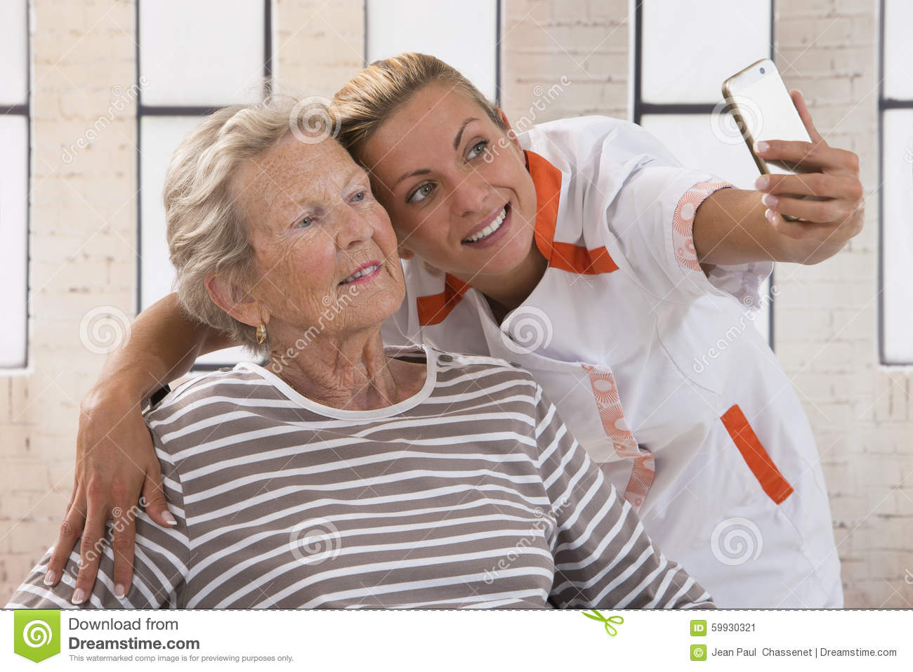 Young Nurse Taking A Selfie To Ensure The Family Stock ...
