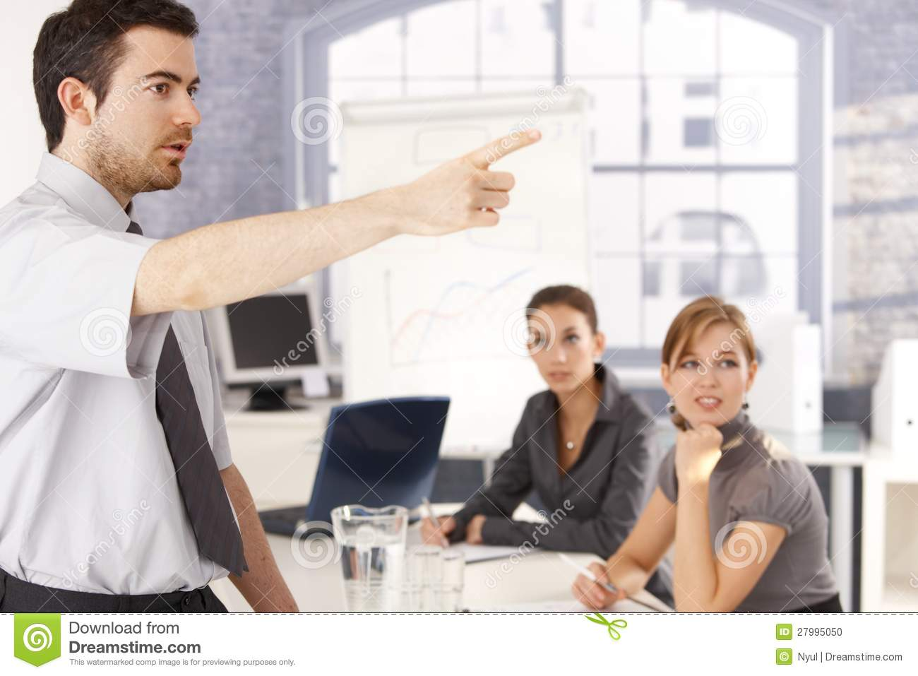 Young office worker leading business training