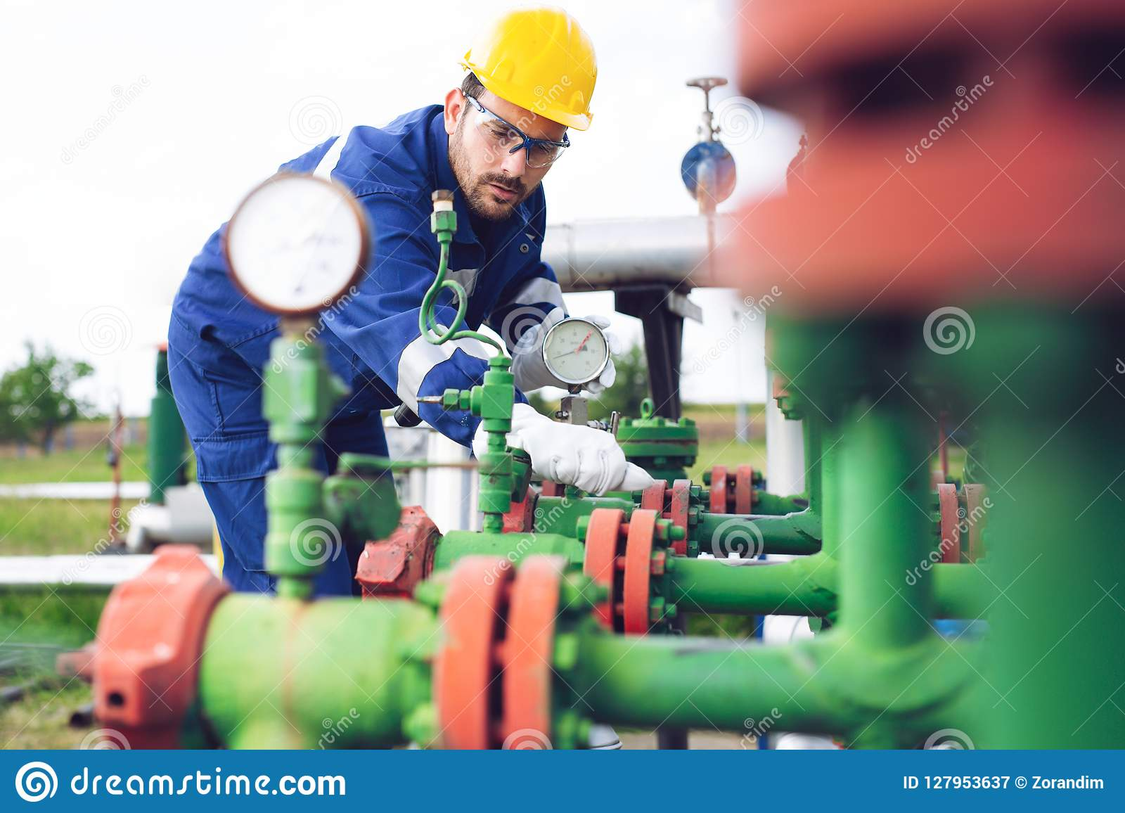 Operator recording operation of oil and gas process at oil and rig plant