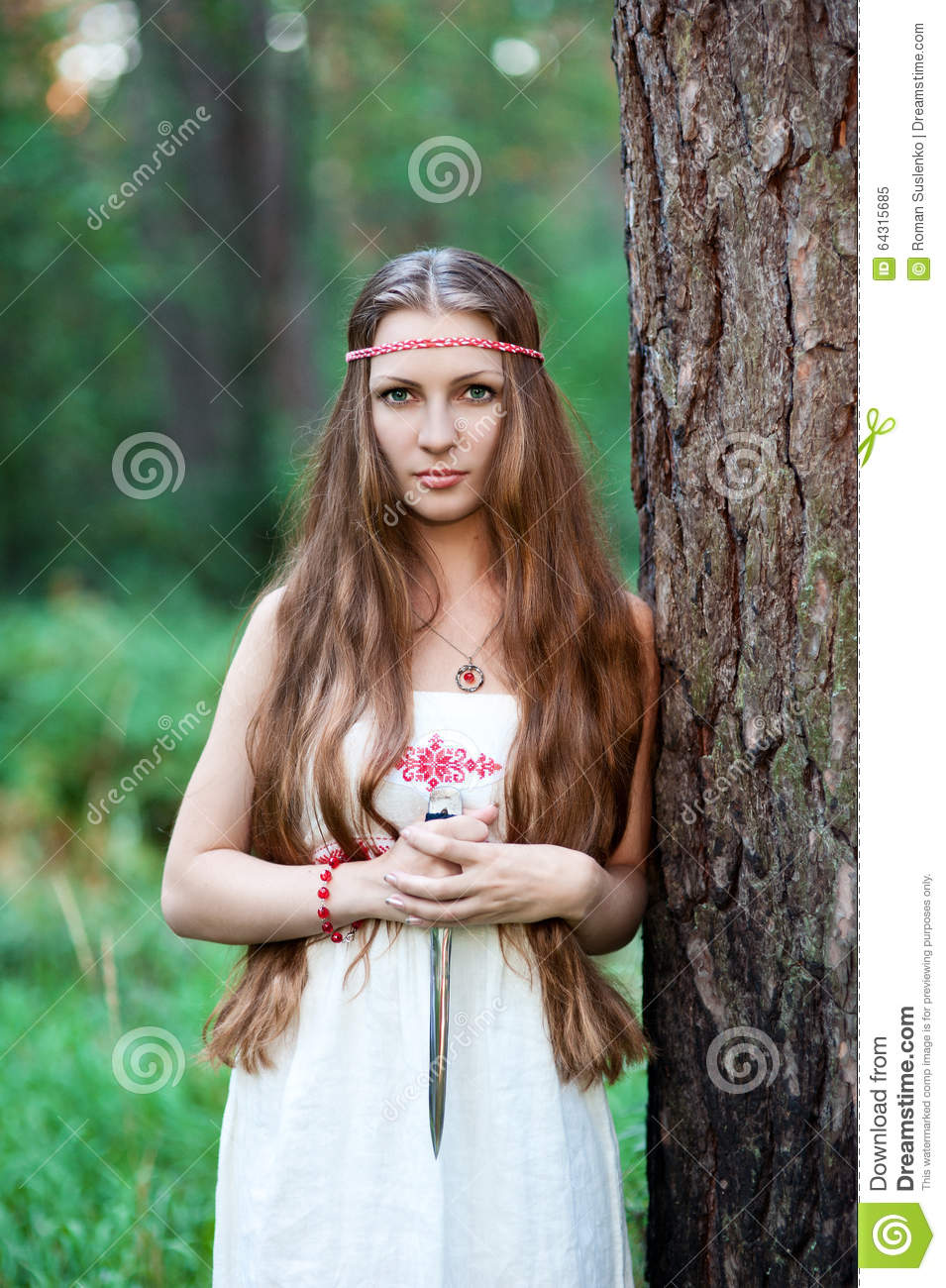 Girl With The Blog: Young Pagan Slavic Girl With A Dagger Stock Image