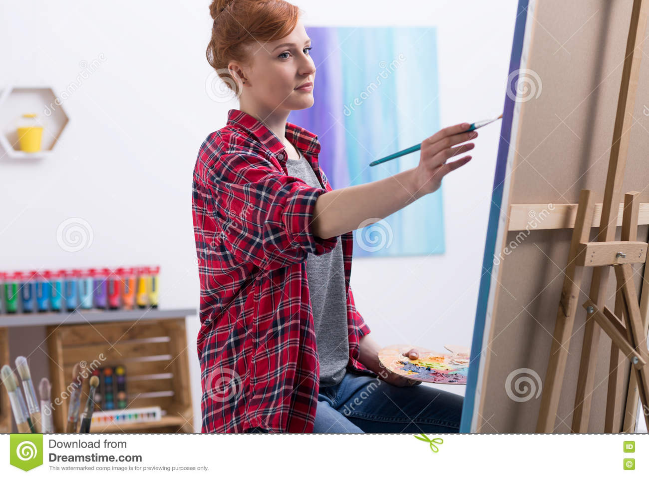 Young painter at work in her studio
