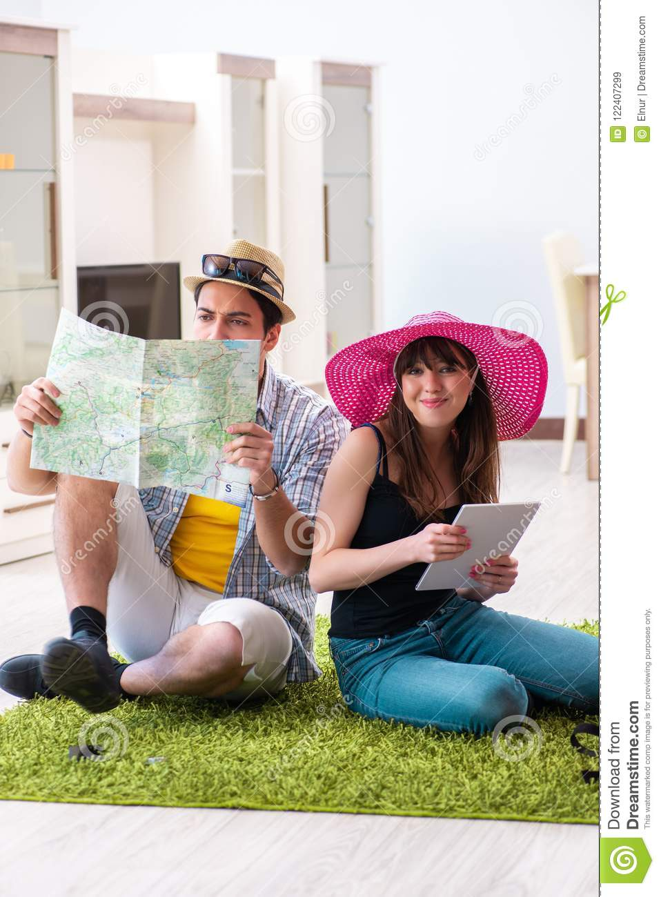 The Young Pair Planning Their Honeymoon Camping Trip Stock